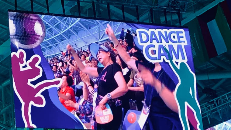 'Dance Cam' gets the crowd moving during the diving competition