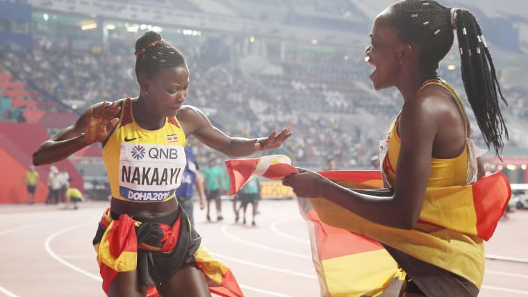 Halimah Nakaayi dances in celebration with fellow Ugandan finalist Winnie Nanyondo after winning the 800m at the IAAF World Championships in Doha