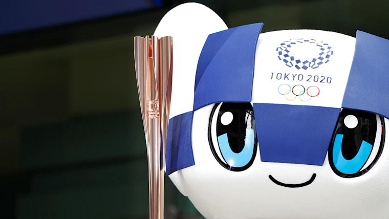 Tokyo 2020 Olympic Games mascot Miraitowa holds the torch of the Tokyo 2020 Olympic Games