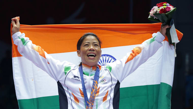 Mary Kom celebrates her flyweight gold at the 2014 Asian Games in Incheon, South Korea