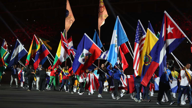 Flag bearers of participating countries walk thru the field during the closing ceremony of Pan American Games Lima 2019 at Estadio Nacional de Lima on August 11, 2019 in Lima, Peru. (Photo by Raul Sifuentes/Getty Images)