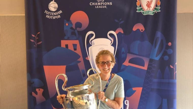 Judith with the Champions League trophy in Madrid where she was a volunteer. Photo: Judith's Facebook.