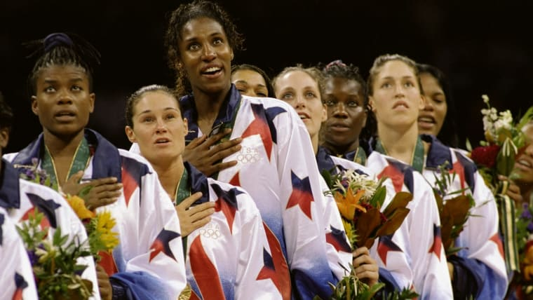 USA's Lisa Leslie stands with her team-mates after taking basketball gold at the 1996 Olympic Games