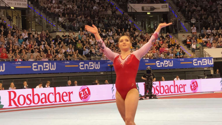 Aliya Mustafina thanks the crowd after her floor routine at the All-Around World Cup in Stuttgart