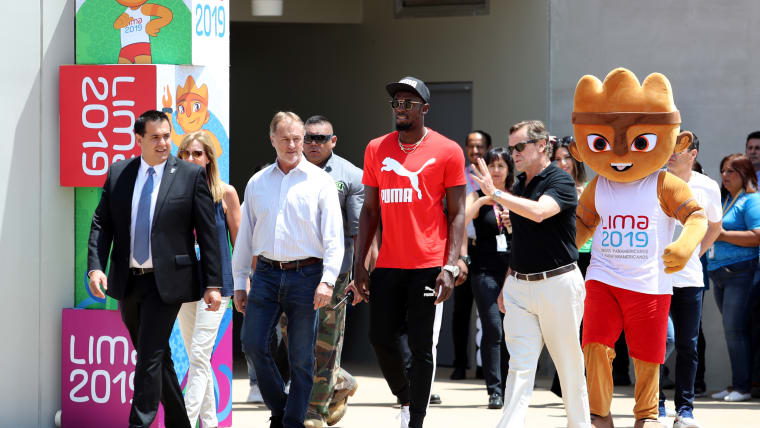 Fast enough for ya? Bolt takes part in the inauguration of the new track at the Villa Deportiva Nacional (VIDENA) which will play host to America's best at the Lima 2019 Pan Ams Games Lima. (Photo by Raul Sifuentes/Getty Images)