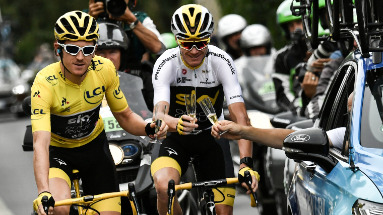 Geraint Thomas celebrates his 2018 Tour de France victory with four-time winner Chris Froome