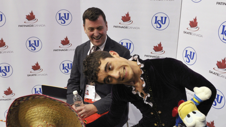 Javier Fernandez and Brian Orser after the free skate at Skate Canada in October 2011