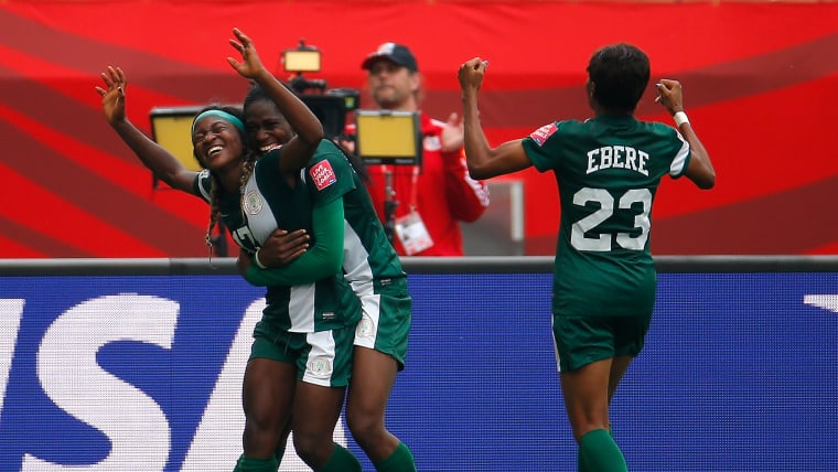 Asisat Oshoala hugs Francisca Ordega after her goal against Sweden in the 2015 FIFA World Cup