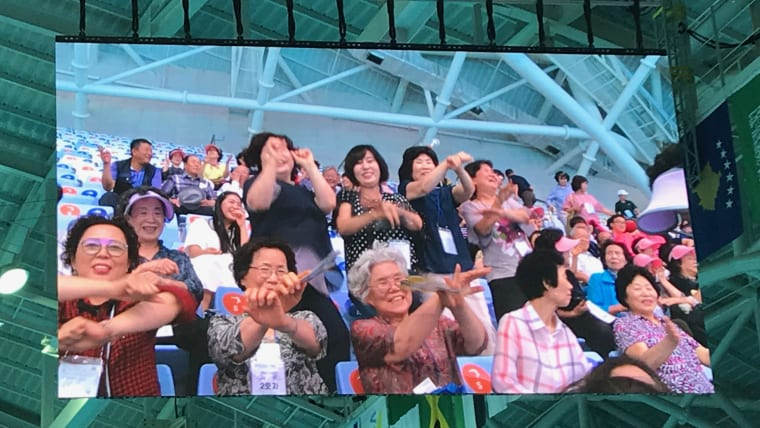 Crowd members give their best rendition of the Korean Gangnam Style dance