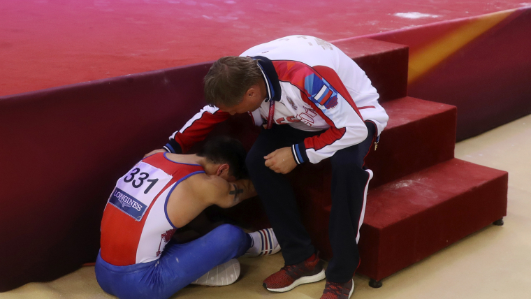 The desperation of Artur Dalaloyan after his mistake in the parallel bars