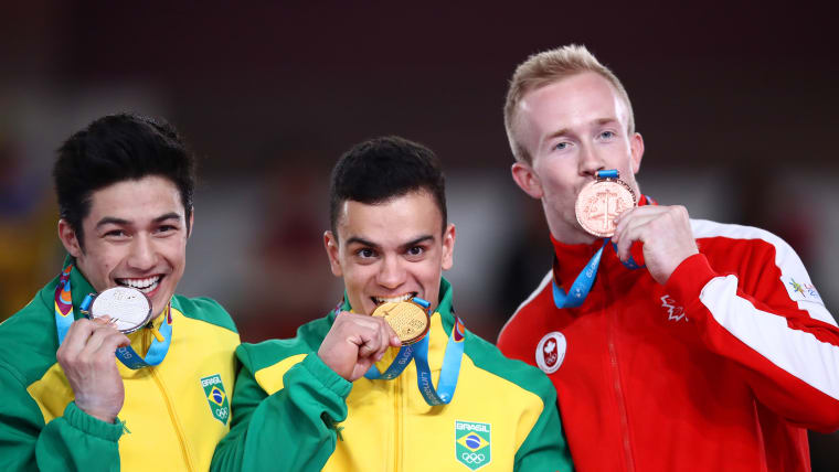 The men's all-around medalists pose in Lima. (Photo by Ezra Shaw/Getty Images)