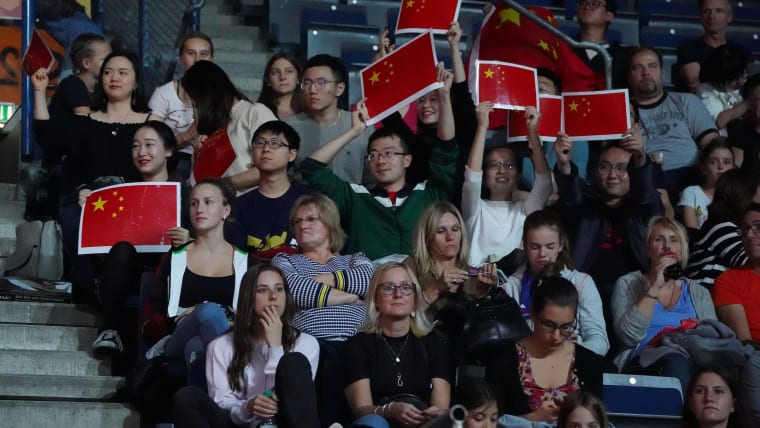 Chinese fans cheering at the 2019 Artistic Gymnastics World Championship (Photo: Olympic Channel)