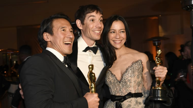 Alex Honnold (middle) celebrates winning Academy Award