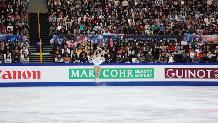 Rika Kihira performing a jump during her short program in Saitama
