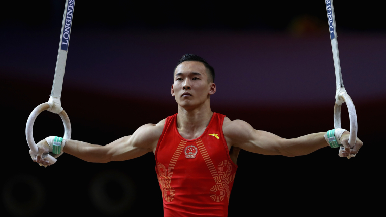 Defending champion Xiao Ruoteng scores 14.333 on the rings on his way to all-around silver in Doha