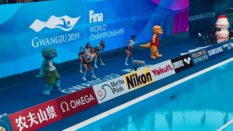 The Gwangju 2019 mascots join the cheerleaders for a dance at the water polo arena