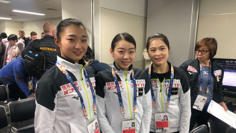 (Left to right) Kaori Sakamoto, Rika Kihira, and Satoko Miyahara pose after the draw for the ladies' short program.