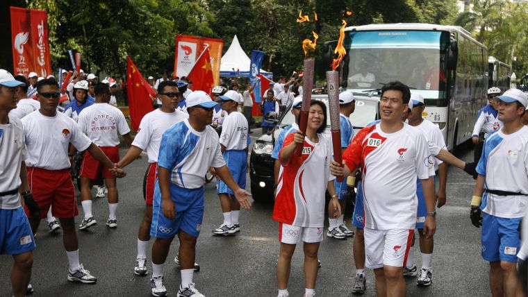 Susi Susanti and Alan Budi Kusuma carried the Olympic flame during the torch relay in 2008.