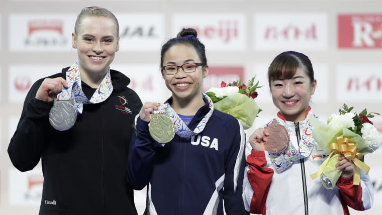 Gold medallist Morgan Hurd (C) of the United States celebrates with silver medalist Ellie Black (L) of Canada and bronze medalist Asuka Teramoto of Japan at the award ceremony for the Women's competition during the FIG Artistic Gymnastics All-Around World Cup Tokyo at Musashino Forest Sport Plaza on April 7, 2019 in Chofu, Tokyo, Japan. (Photo by Kiyoshi Ota/Getty Images)