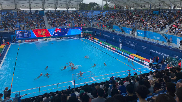 Montenegro take on Australia in men's water polo in front of a healthy crowd