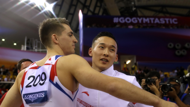 China's Xiao Ruoteng embraces Max Whitlock after beating the Briton in the pommel horse on a tie-break