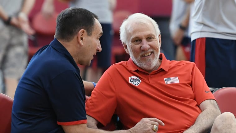 USA head coach Gregg Popovich (R) speaks with his predecessor Mike Krzyzewski