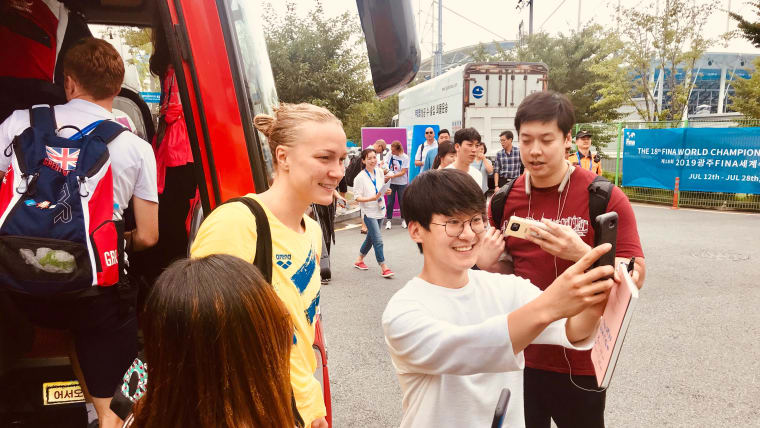 Olympic champion Sarah Sjostrom poses with fans in Gwangju