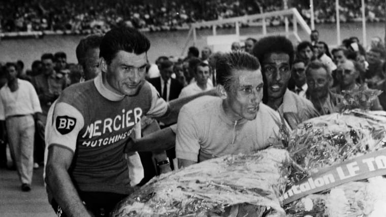 Runner-up Raymond Poulidor (L) congratulates Jacques Anquetil on his fifth consecutive Tour de France win in July 1964.