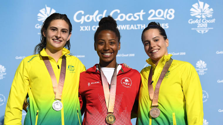 Silver medalist Maddison Keeney of Australia (left), gold medalist Jennifer Abel of Canada and bronze medalist Anabelle Smith of Australia at the medal ceremony for the Women's 3m Springboard Diving Final at the Gold Coast 2018 Commonwealth Games April 14, 2018. (Photo by Quinn Rooney/Getty Images)