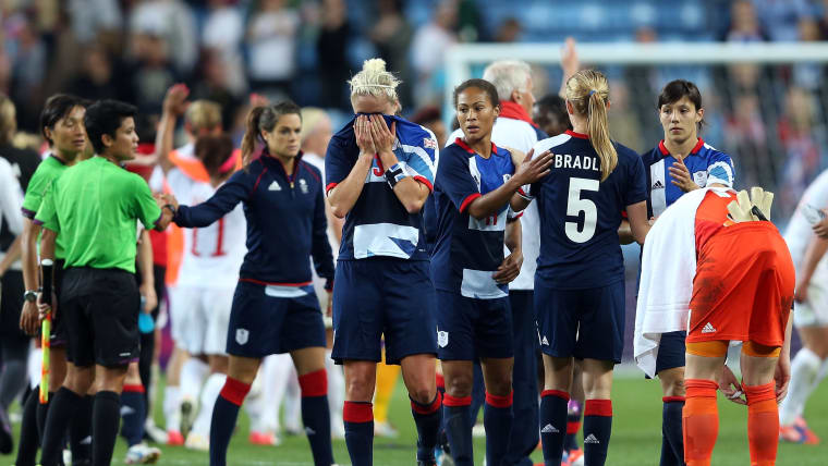 Team GB players commiserate with each other after their London 2012 quarter-final exit to Canada