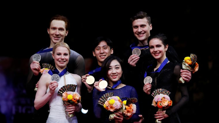 The 2019 world championship pairs medallists: China's Sui Wenjing and Han Cong in first place, Russia's Evgenia Tarasova and Vladimir Morozov in second place and Russia's Natalia Zabiiako and Alexander Enbert in third place. (REUTERS/Issei Kato)