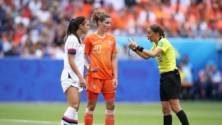 Stephanie Frappart speaks to USA's Alex Morgan and the Netherlands' Dominique Bloodworth during the 2019 FIFA Women's World Cup Final