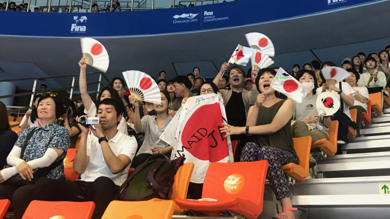 Japanese fans supporting their team at the artistic swimming