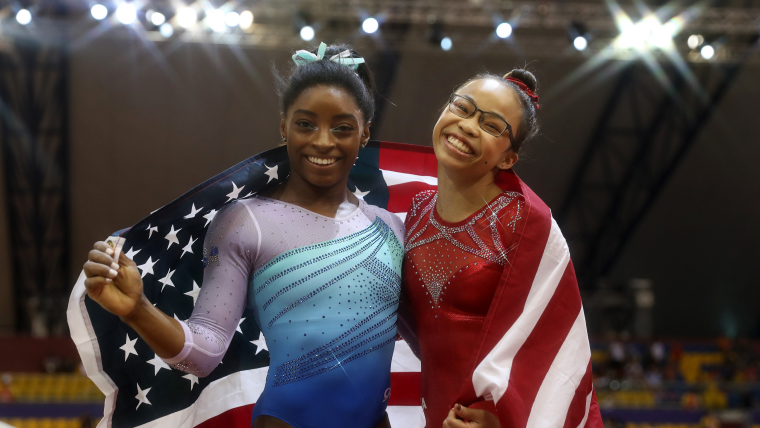 Simone Biles (gold) and Morgan Hurd (bronze) celebrate after the Women's All-Around final