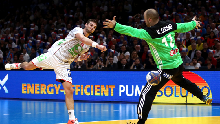 Norway's Bjarte Myrhol beats French goalkeeper Vincent Gerard in the final of the 2017 World Championships in Paris