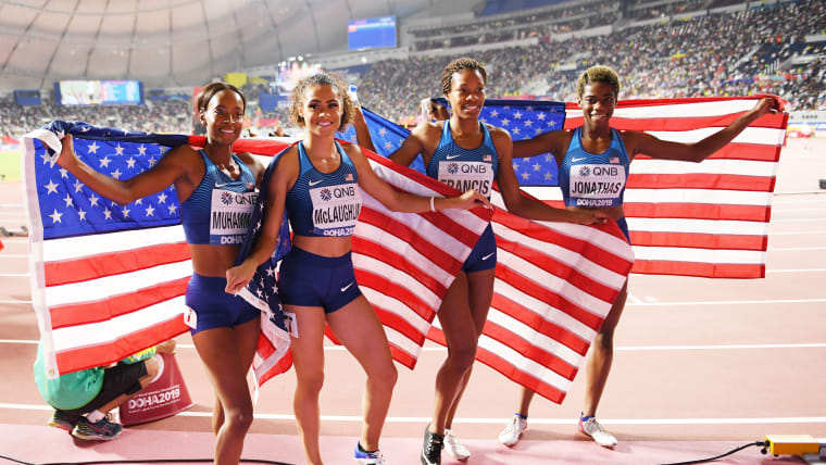 Phyllis Francis, Sydney Mclaughlin, Dalilah Muhammad and Wadeline Jonathas of the United States celebrate winning gold in the Women's 4x400 metres relay final during day ten of 17th IAAF World Athletics Championships Doha 2019 at Khalifa International Stadium on October 06, 2019 in Doha, Qatar. (Photo by Matthias Hangst/Getty Images)