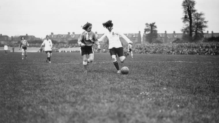 Dick, Kerr Ladies' FC (white) take on a French women's team at Herne Hill, London in May 1925