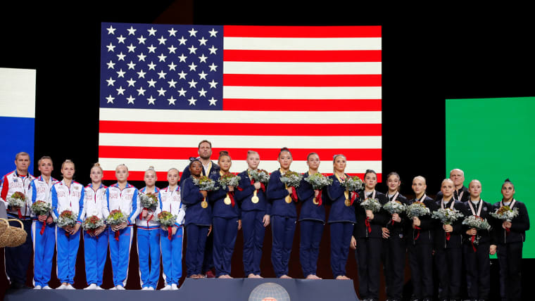 Russia (silver), USA (gold), and Italy (bronze) during the medal ceremony for the women's team final at the 2019 World Championships (REUTERS/Wolfgang Rattay)