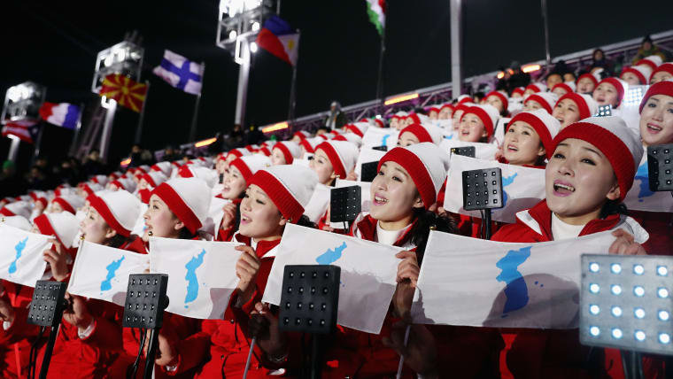 North Korean cheerleaders hold Korean Unification flags during the Opening Ceremony