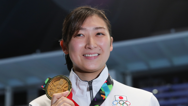 Rikako Ikee poses with one of her six gold medals from the 2018 Asian Games in Jakarta