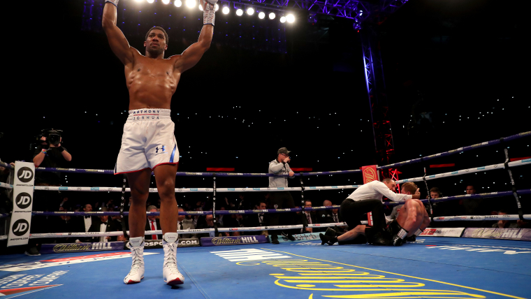 Anthony Joshua triumphs with a seventh-round stoppage against Alexander Povetkin