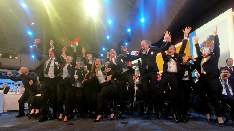 Italian supporters cheer after Milan Cortina win the Host City Election 2026. (Greg Martin/IOC)
