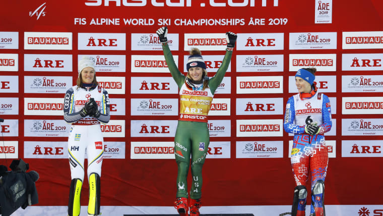 Women's slalom winner Mikaela Shiffrin of the USA (centre), second placed Sweden's Anna Swenn Larsson (left) and third placed Slovakia's Petra Vlhova (right) celebrate on the podium. [REUTERS/Leonhard Foeger]