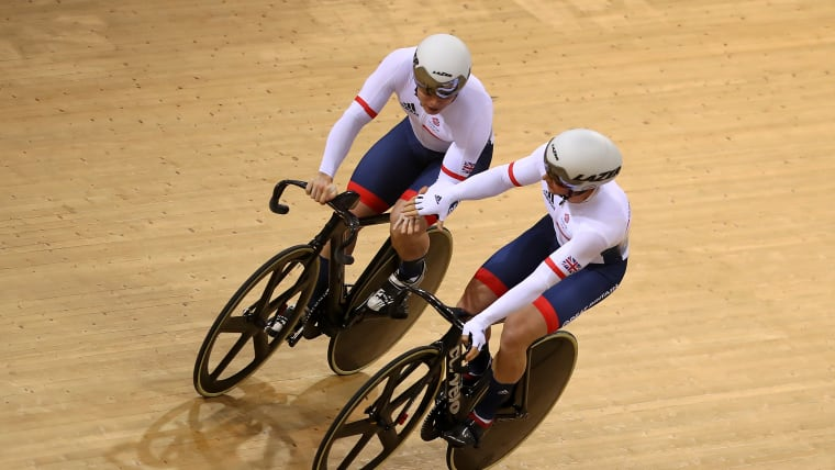 Jason Kenny (R) was eliminated by team-mate Jack Carlin in the men's sprint in Minsk