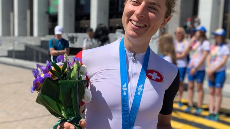 Marlen Reusser is beaming after she won the women's road race time trial, but has to jump straight on a flight home to make nationals: