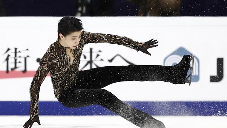 Yuzuru Hanyu of Japan falls down during his triple Axel attemp