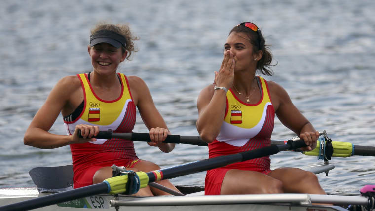 Anna Boada (L) and Aina Cid react after qualifying from their heat in the pair at Rio 2016