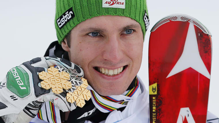 Marcel Hirscher poses with his one silver and two gold medals from the 2013 World Championships in Schladming