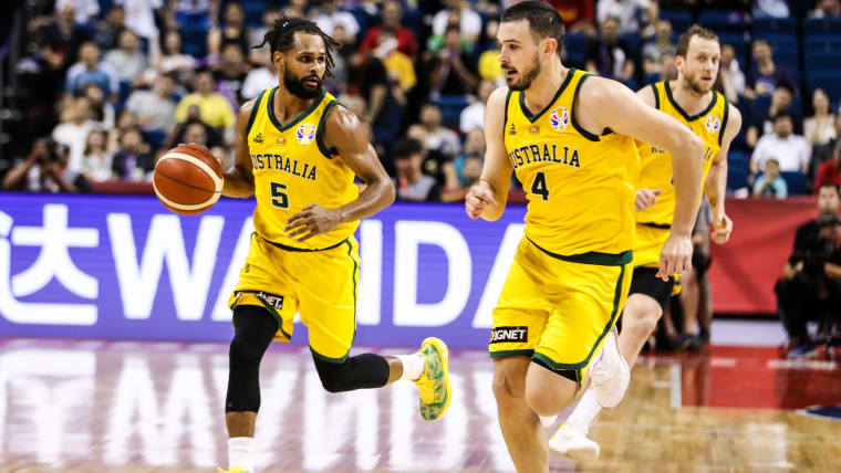 Patty Mills (L) #5 of Australia in action during 2nd round Group L match between Australia and Dominican Republic of 2019 FIBA World Cup at Nanjing Youth Olympic Sports Park Gymnasium on September 09, 2019 in Nanjing, China. (Photo by Shi Tang/Getty Images)
