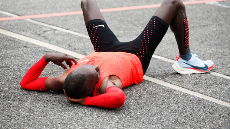 Eliud Kipchoge on the ground after his unsuccessful Breaking 2 attempt at Monza
